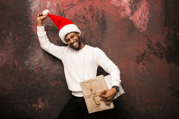 Afro american man holding christmas presents Free Photo