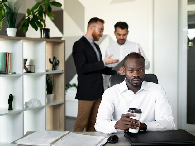 Afro american man sitting at desk Free Photo
