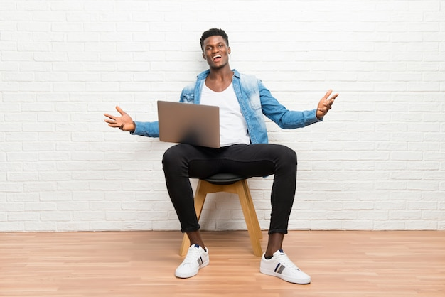 Afro american man working with his laptop proud and self-satisfied in love yourself concept Premium Photo