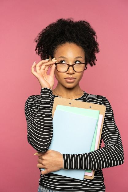 Afro-american tutor or teacher woman isolated on pink  wall Premium Photo