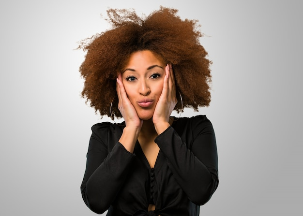 Afro woman being surprised Premium Photo