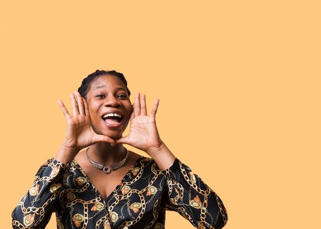 Afroamerican model shouting copy space Free Photo