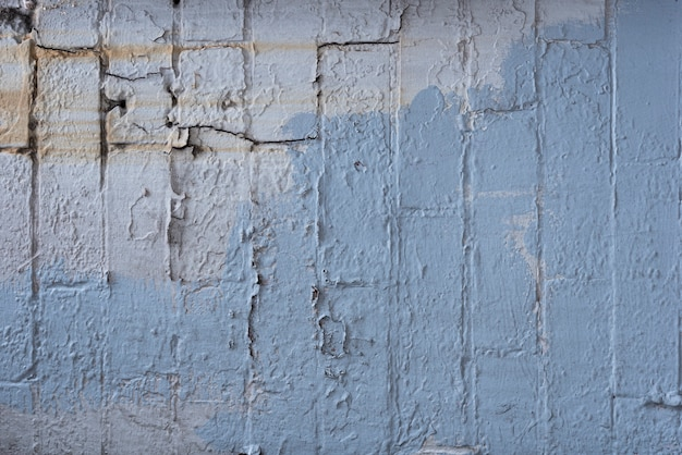 Aged brick wall with paint Free Photo