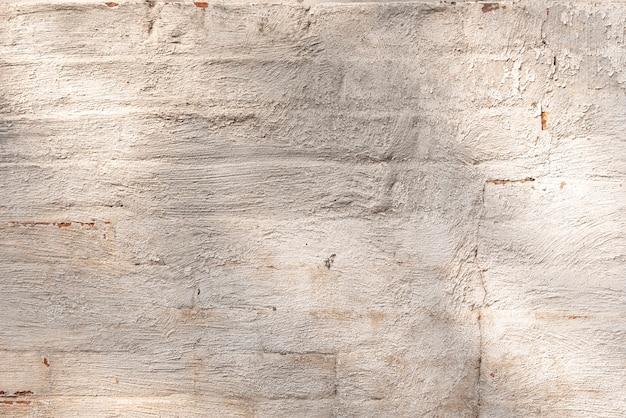 Aged building wall made of bricks Free Photo