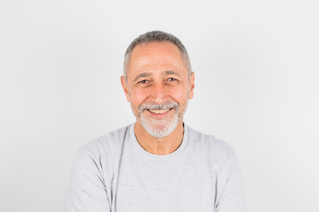 Aged cheerful man in t-shirt Free Photo