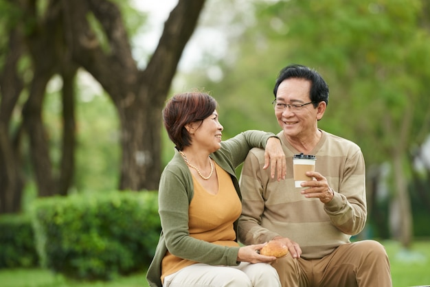 Aged couple resting in park Free Photo