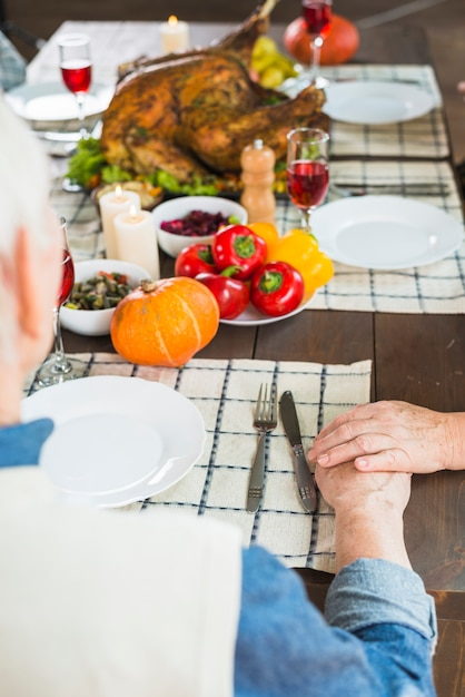 Aged couple sitting at festive table Free Photo