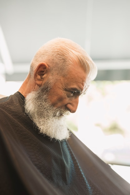 Aged male in barber shop Free Photo