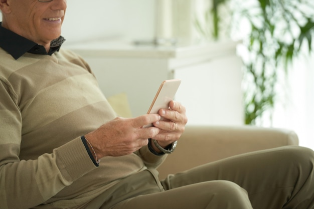 Aged man with smartphone Free Photo