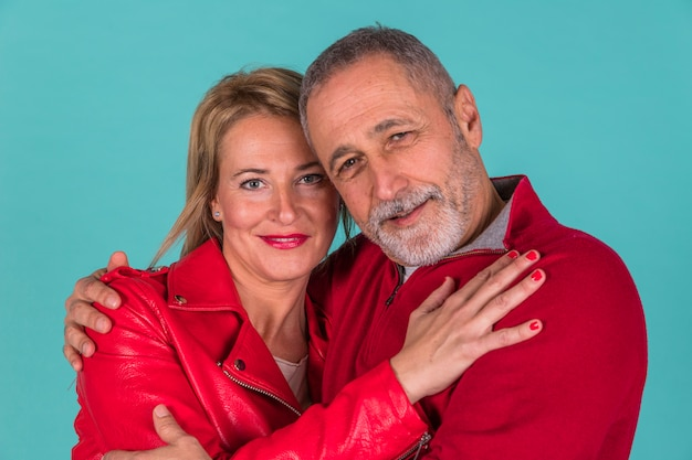 Aged positive man hugging with attractive woman Free Photo