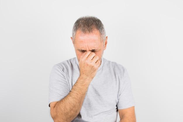 Aged sad man in t-shirt Free Photo