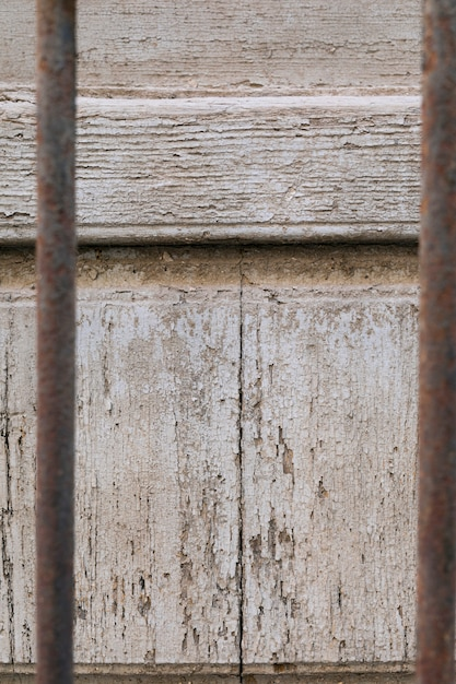 Aged wood surface and rusty metal bars Free Photo