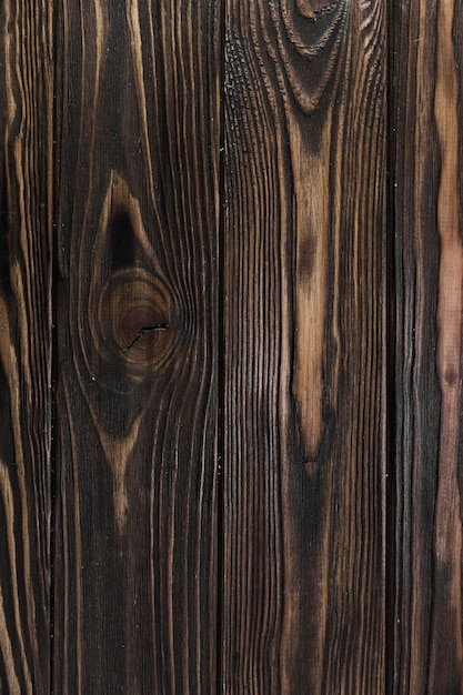 Aged wood surface with grain and knots Free Photo