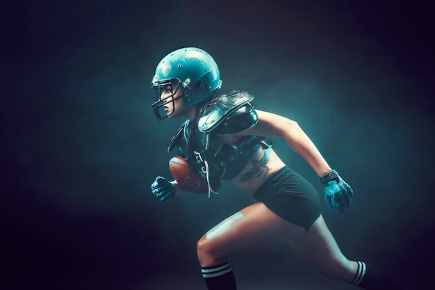 Aggressive sportswoman playing rugby Premium Photo