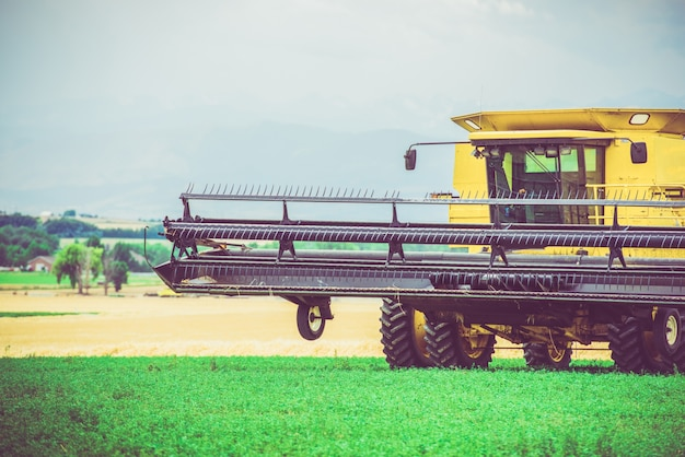 Agriculture works harvester Free Photo
