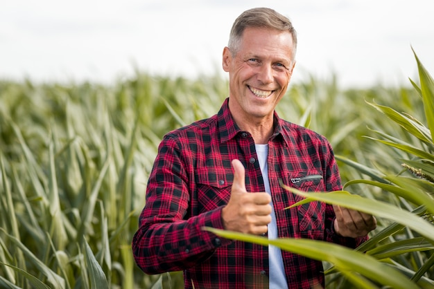 Agronomist showing thumb up medium view Premium Photo