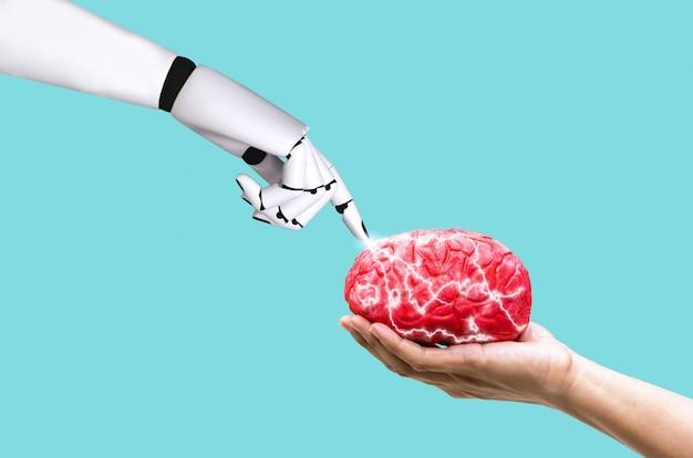 Концепция мозга ai робота руки в памяти команд на человеческом удерживании руки Premium Фотографии