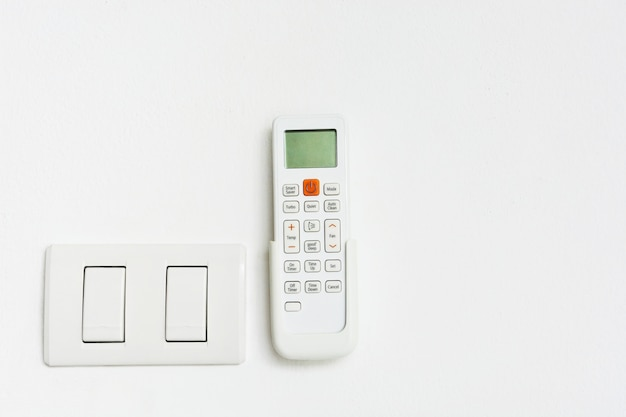 Air-condition and light switch on white background with copy space Premium Photo
