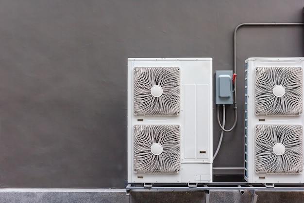 Air conditioning compressor installation on pedestal. Premium Photo