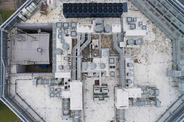 Air conditioning equipment atop a modern building - aerial view of the roof with all the necessary installations Premium Photo