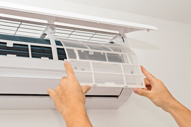 Air conditioning on a white wall Premium Photo