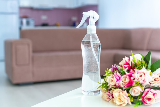 Air freshener on table for pleasant fresh floral smell in room at home Premium Photo
