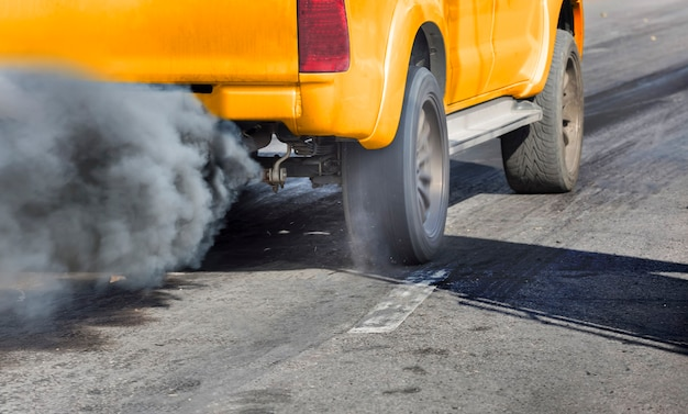 Air pollution from vehicle exhaust pipe on road Premium Photo