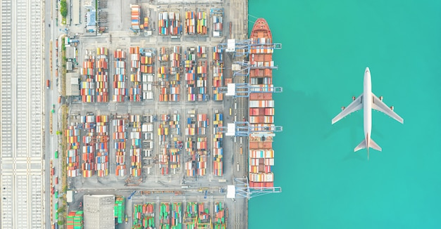 Air transportation and transit of container ships loading and unloading in hutchison ports, business logistic import-export transport sea freight Premium Photo