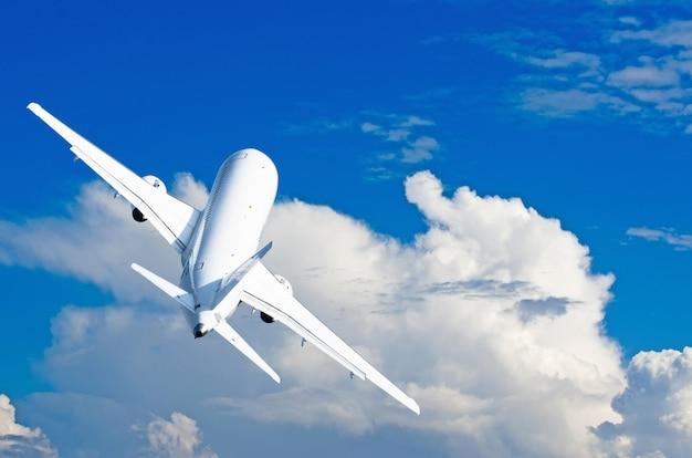 Aircraft climb flight against the cumulus clouds in sky Premium Photo
