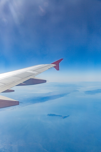Aircraft wing on the clouds Premium Photo