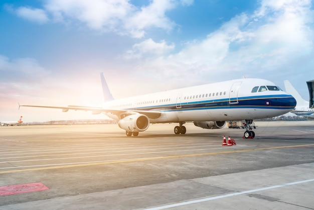 An airliner on the runway apron Premium Photo