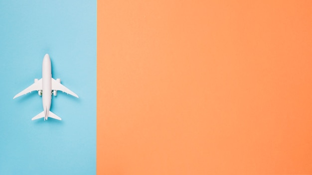 Airplane on different color background Free Photo