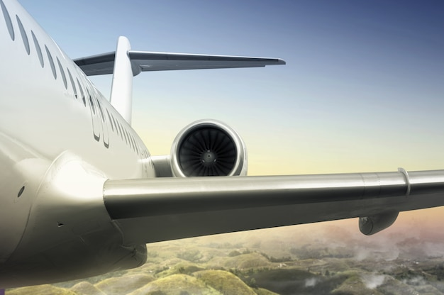 Airplane flying in the air above the landscape Premium Photo