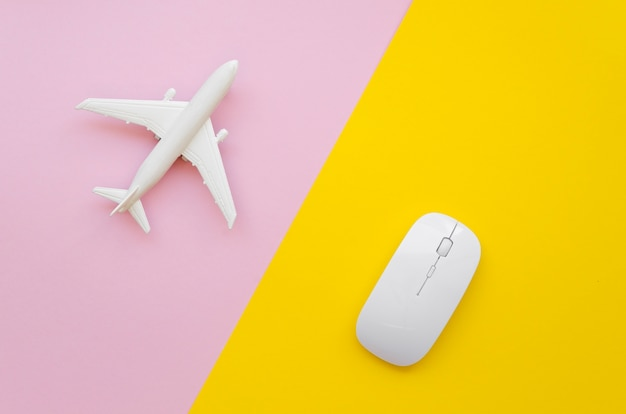 Airplane and mouse on table Free Photo