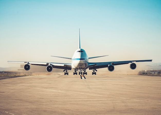 Airplane parking on an airport runway in sunny day . Premium Photo