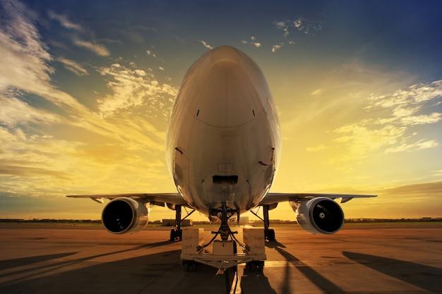 Airplane at sunset Free Photo