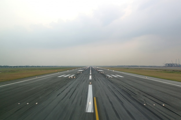 Airport runway in the evening with light system opened. Premium Photo
