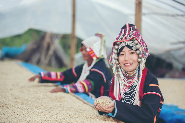 Akha women smiled and admired the coffee Free Photo