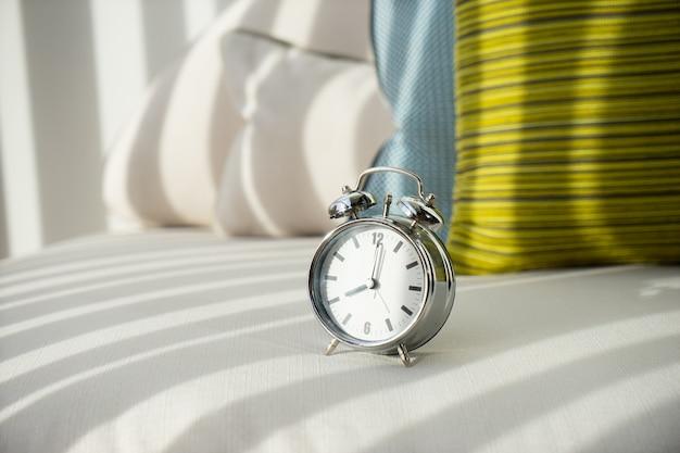 Alarm clock at 8 am. to wake up Premium Photo