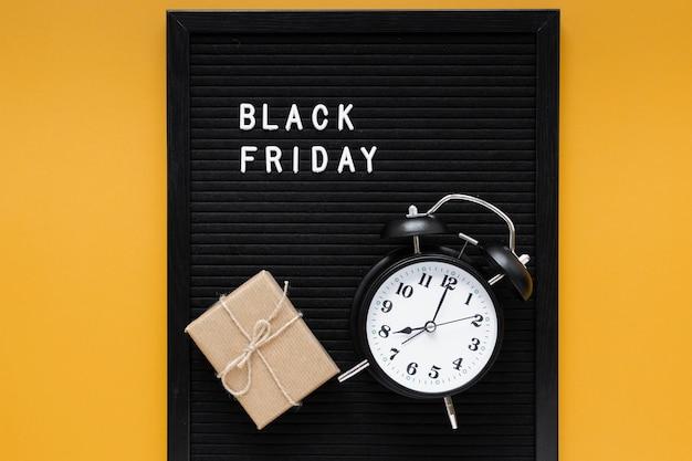 Alarm clock on black friday frame Free Photo