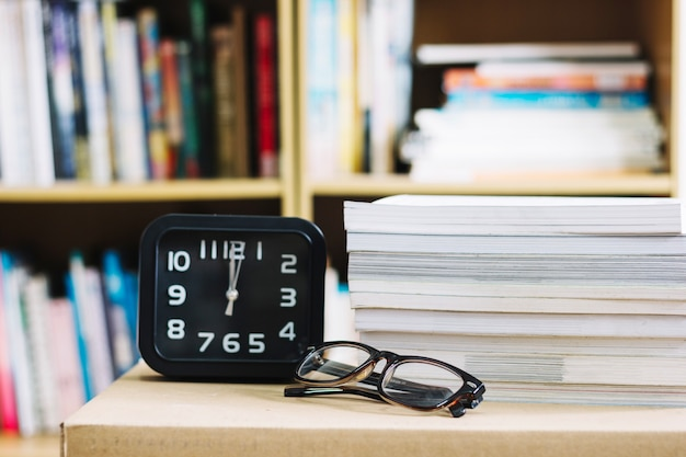 Alarm clock and glasses Free Photo