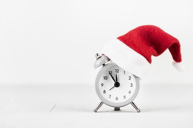 Alarm clock with santa hat Free Photo