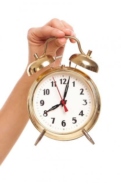 Alarm clock in woman's hand Free Photo