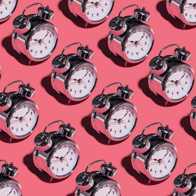 Alarm clocks on pink background Free Photo