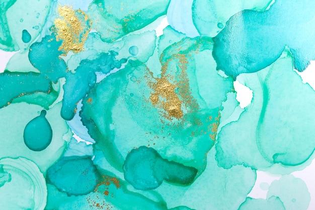 アルコールインクブルー抽象的な背景。オーシャンスタイルの水彩テクスチャ。青と金の塗料汚れ Premium写真