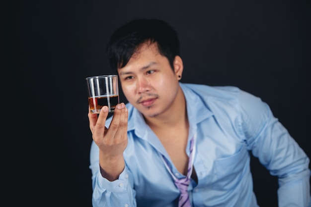 Alcoholic asian man with a whisky glass Free Photo
