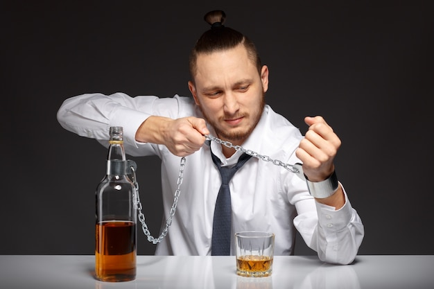 Alcoholic man struggling with his problem Free Photo