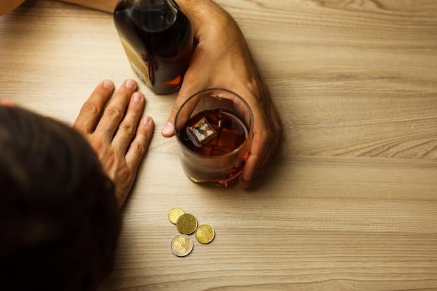Alcoholism and depression due to job loss Premium Photo