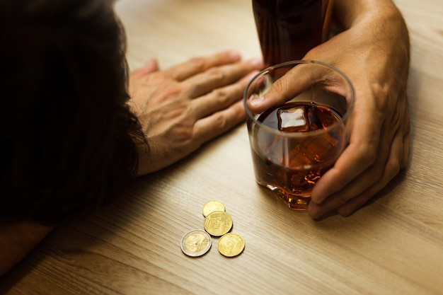Alcoholism and depression due to job loss Premium Photo