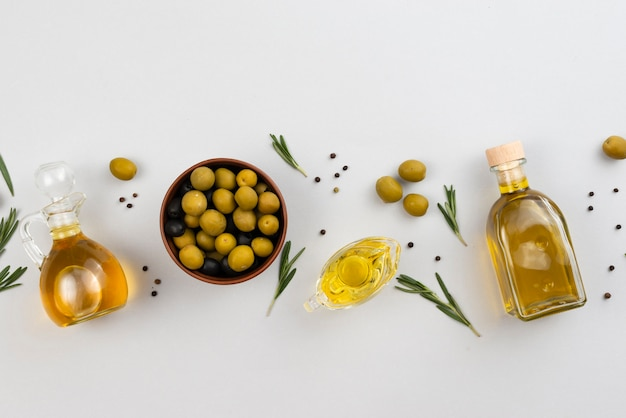 Aligned olive oil products on tables Free Photo